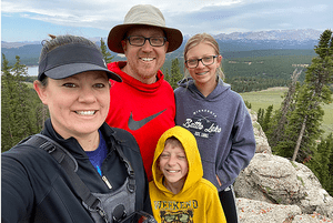 Andrea Leesch, husband and kids posing in National Park