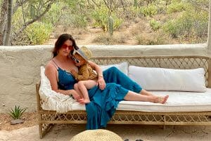 Sara Isley reclining with baby in lap