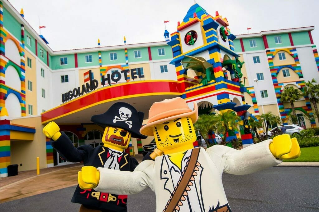 Lego characters standing outside Legoland Hotel New York