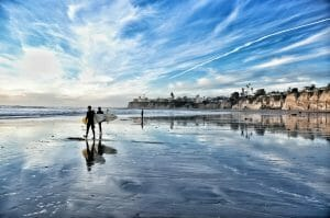 Surfers walking on the beach in San Diego