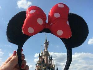 minnie mouse ears framing disneyland castle