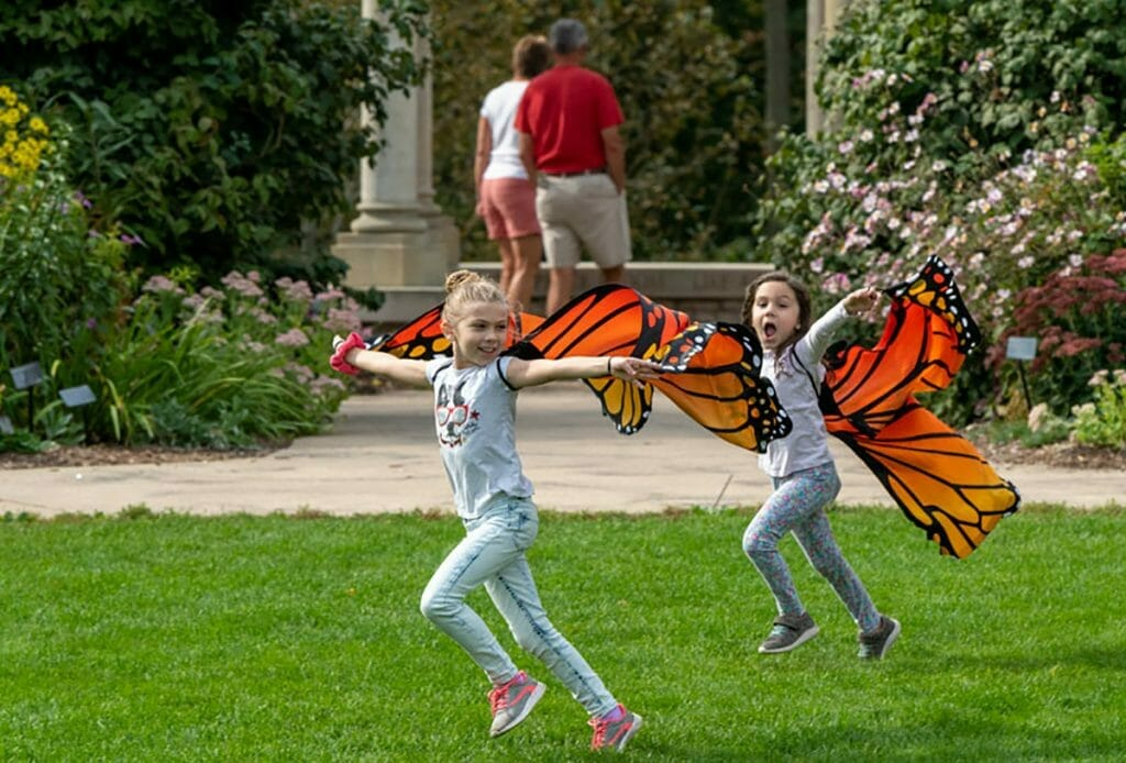 girls wearing wings at the Green Bay Botanlica Garden