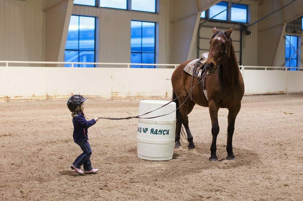 Training horses at the Resort at Paws Up