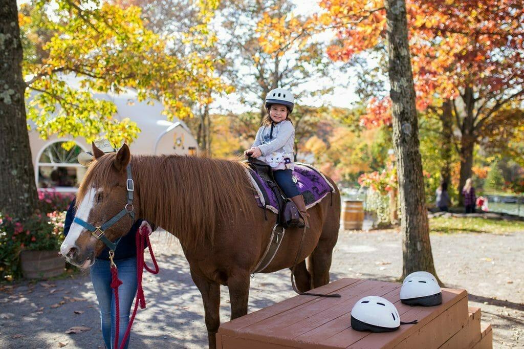 Girl riding a horse at Rocking Horse Ranch