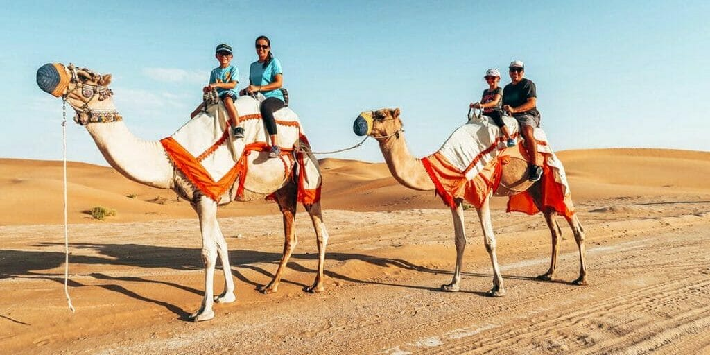 fiorante family of passport kids riding on camels