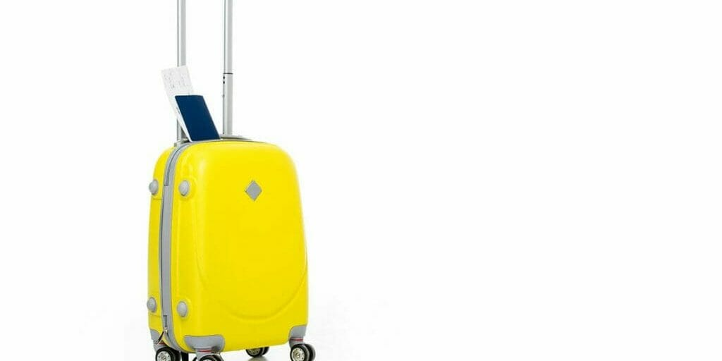 minmalist yellow suitcase on white background